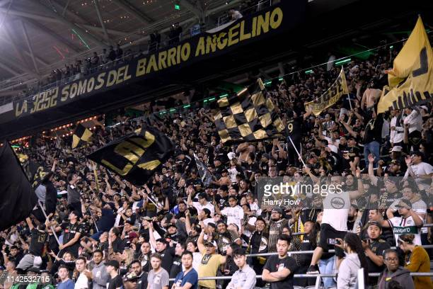 Los Angeles FC fans cheer during the first against the FC Cincinnati half at Banc of California Stadium on April 13, 2019 in Los Angeles, California.
