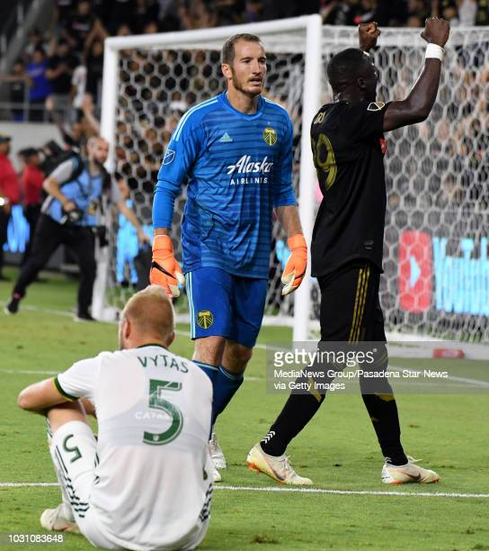 Los Angeles FC forward Adama Diomande reacts toward the crowd after defeating the Portland Timbers 32 as Portland Timbers goalkeeper Jeff Attinella...