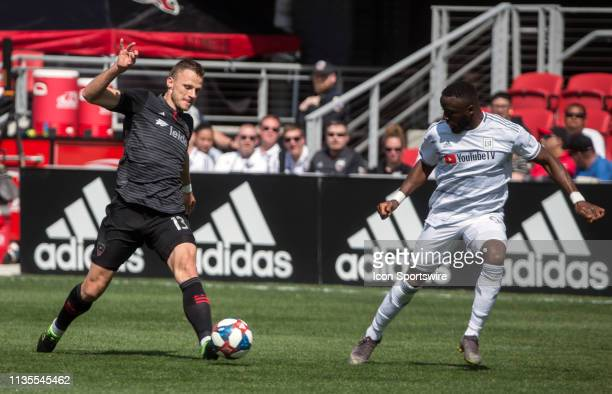 Los Angeles FC forward Adama Diomande watches the movement of DC United defender Frederic Brillant during a MLS match between DC United and Los...