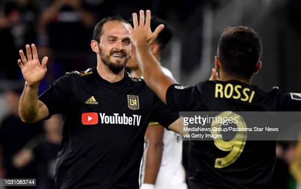 Los Angeles FC forward Marco Urena celebrates with teammate forward Diego Rossi against the Portland Timbers in the second half of a Major league...