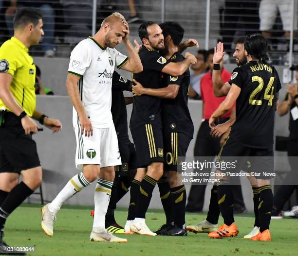 Los Angeles FC forward Marco Urena celebrates with teammates after scoring against the Portland Timbers in the first half of a Major league Soccer...