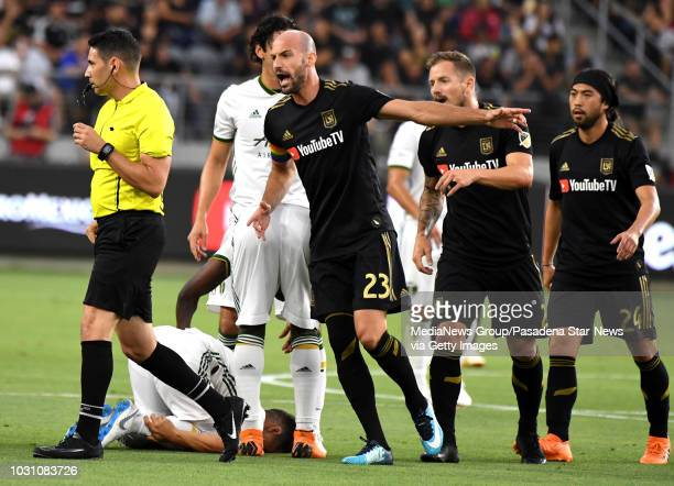 Los Angeles FC forward Marco Urena, center, hugs teammates after scoring against the Portland Timbers in the first half of a Major league Soccer U.S....