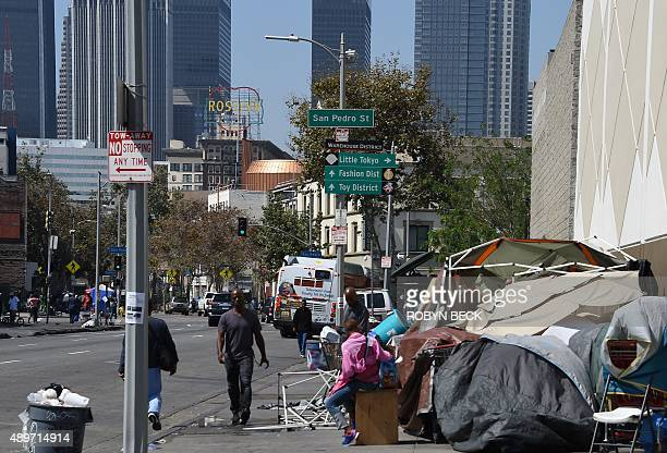 Los Angeles financial district skyscrapers are seen behind a homeless tent encampment September 23 2015 in downtown Los Angeles Los Angeles officials...