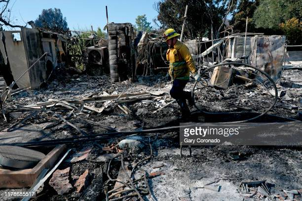 Los Angeles Fire Department mops up after a home was destroyed along the 12000 block of Sky Lane in the Getty fire in Los Angeles Calif on Oct 28...