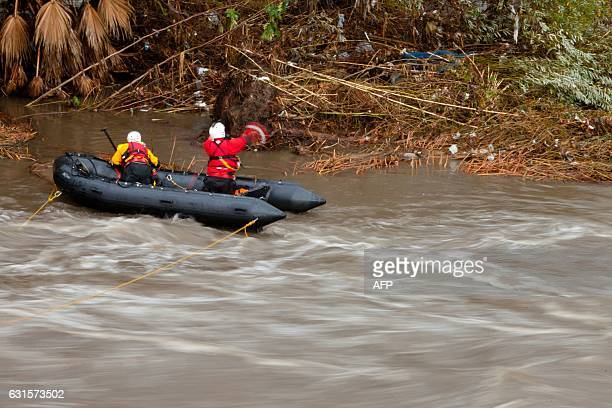Los Angeles Fire Department's Swift Water Rescue personnel search for a possible deceased individual on an island in the middle of the LA River near...