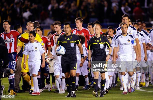 Los Angeles Galaxy and of Chivas USA soccer teams enter the Home Depot Center for their MLS soccer match on April 1 2010 in Carson California