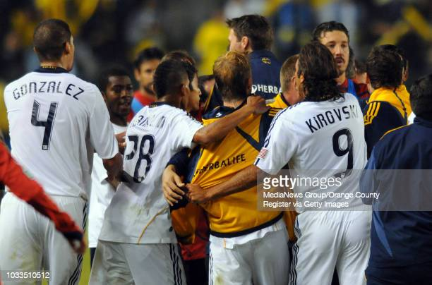CARSON 11/08/09 Los Angeles Galaxy beat Chivas USA 10 to advance to the MLS Western Conference finals 2nd half David Beckham center in yellow is held...