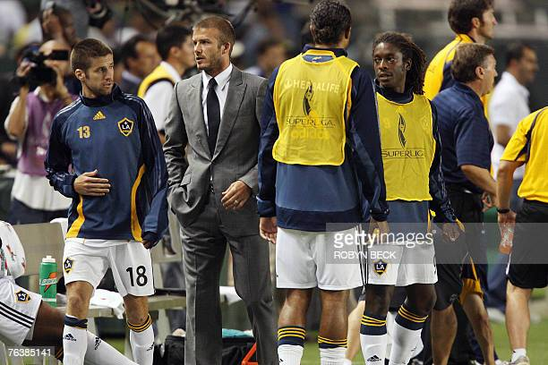 Los Angeles Galaxy captain David Beckham on the sidelines with teammates after injuring his right knee during second half Superliga final action...