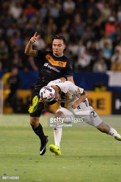 Los Angeles Galaxy defender Hugo Arellano goes for the ball with his head against Houston Dynamo forward Erick Torres during the game between the LA...