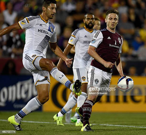 Los Angeles Galaxy defender Omar Gonzalez kicks the ball by Colorado Rapids forward Kevin Doyle during the second half of the Galaxy's 31 win The...