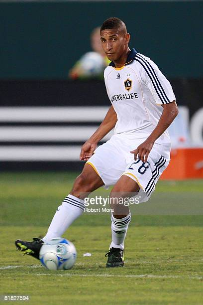 Los Angeles Galaxy Defender Sean Franklin controls the loose ball during their MLS game against the New England Revolution at Home Depot Center on...
