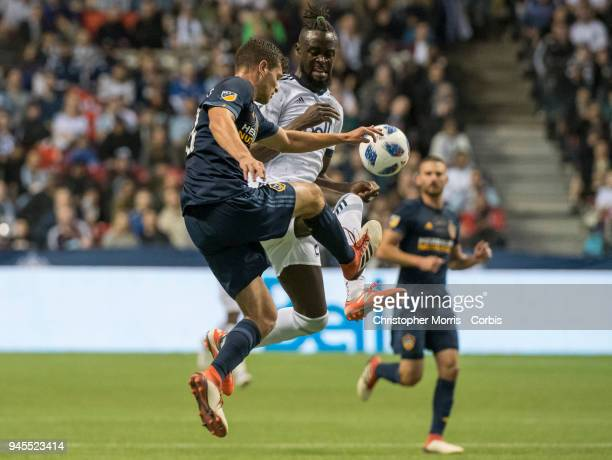 Los Angeles Galaxy defender Tomas HilliardArce and Vancouver Whitecaps forward Kei Kamara compete for the ball at BC Place on March 24 2018 in...