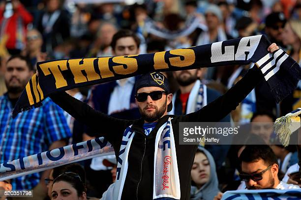Los Angeles Galaxy fan holds a scarf prior to a game against the Portland Timbers at StubHub Center on April 10 2016 in Carson California