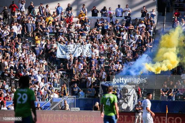 Los Angeles Galaxy fans celebrate after Los Angeles Galaxy forward Zlatan Ibrahimovic scores the opening goal of the 1st half during a MLS game...