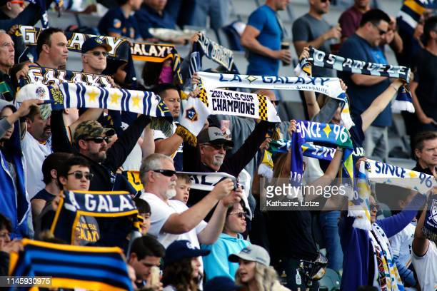 Los Angeles Galaxy fans hold up their scarves ahead of a game against Real Salt Lake at Dignity Health Sports Park on April 28 2019 in Carson...