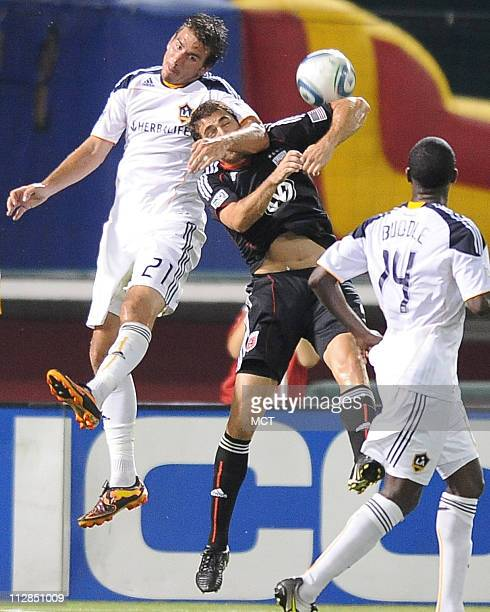 Los Angeles Galaxy forward Alan Gordon locks up with DC United defender Dejan Jakovic while battling for a header in the second half Galaxy defeated...