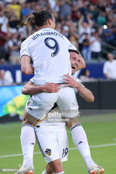 Los Angeles Galaxy forward Chris Pontius celebrates his first half goal with Los Angeles Galaxy forward Zlatan Ibrahimovic in the game between the DC...