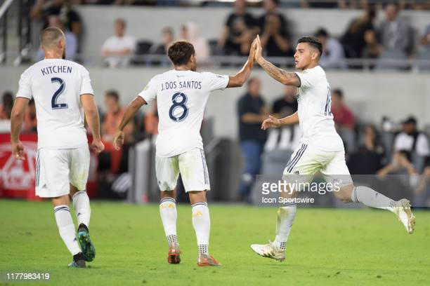 Los Angeles Galaxy forward Cristian Pavon right celebrates his goal in the first half with midfielder Jonathan dos Santos center during a MLS Western...