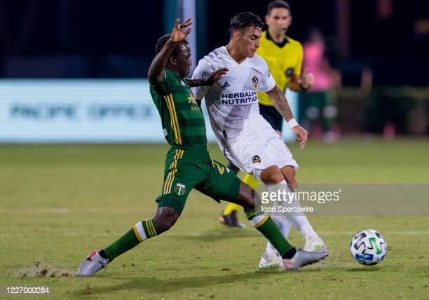 Los Angeles Galaxy forward Cristian Pavon shoots the ball during the MLS Is Back Tournament between the LA Galaxy v Portland Timbers on July 13 2020...