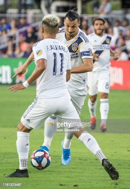 Los Angeles Galaxy forward Favio Alvarez and forward Zlatan Ibrahimovic on the attack during a MLS match between DC United and the LAGalaxy on August...