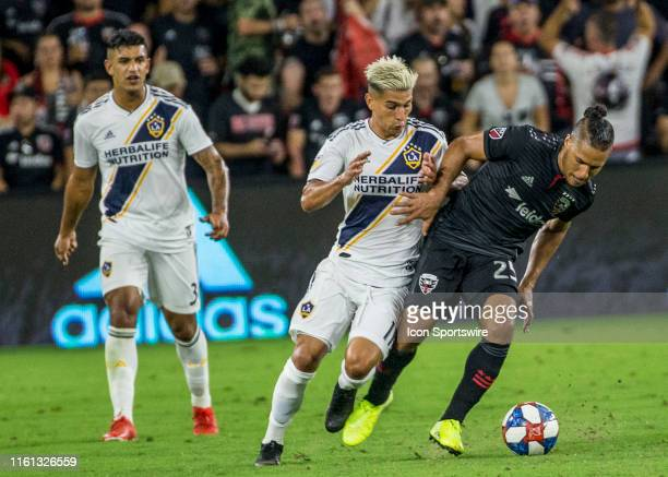 Los Angeles Galaxy forward Favio Alvarez moves into DC United forward Quincy Amarikwa during a MLS match between DC United and the LAGalaxy on August...