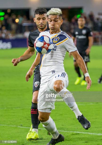Los Angeles Galaxy forward Favio Alvarez shields the ball from DC United midfielder Felipe Martins during a MLS match between DC United and the...