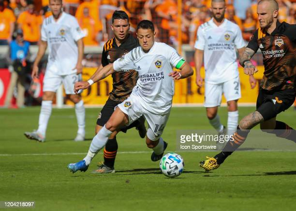 Los Angeles Galaxy forward Javier Hernandez dribbles the ball during the MLS match between the Los Angeles Galaxy and Houston Dynamo on February 29...