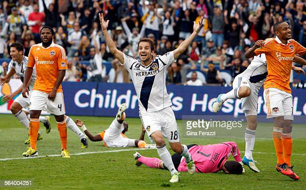 Los Angeles Galaxy forward Mike Magee celebrates Omar Gonzalez second half goal in the Galaxy 31 win over Houston to win the MLS Championship at the...