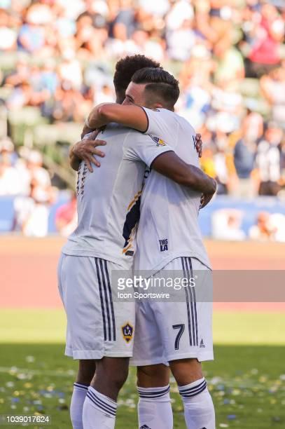 Los Angeles Galaxy forward Ola Kamara is congratulated by Los Angeles Galaxy midfielder Romain Alessandrini after scoring a goal in the 1st half...