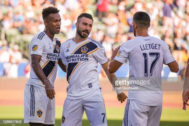 Los Angeles Galaxy forward Ola Kamara is congratulated by Los Angeles Galaxy midfielder Romain Alessandrini and Los Angeles Galaxy midfielder...