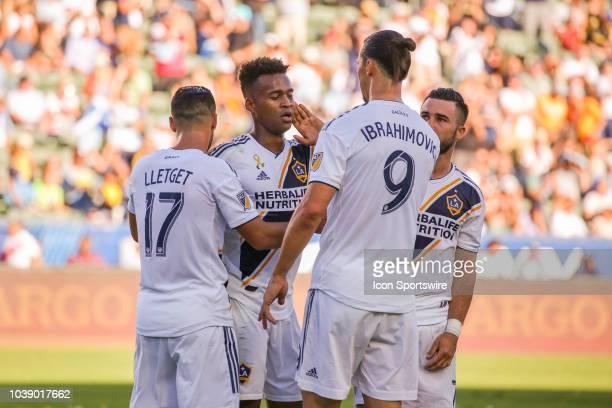 Los Angeles Galaxy forward Ola Kamara is congratulated by Los Angeles Galaxy midfielder Sebastian Lletget Los Angeles Galaxy forward Zlatan...