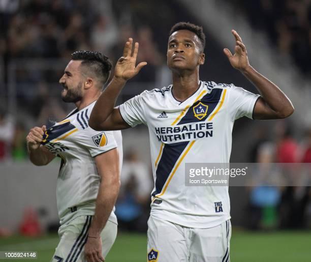 Los Angeles Galaxy forward Ola Kamara right and midfielder Romain Alessandrini celebrate Kamara's goal in the second half during a MLS match between...