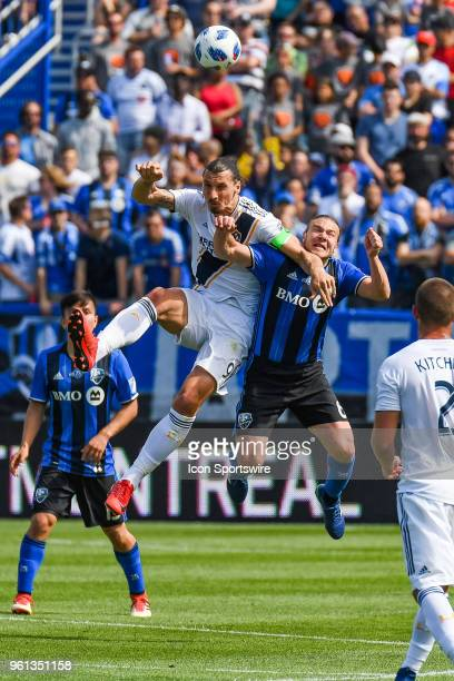 Los Angeles Galaxy forward Zlatan Ibrahimovic and Montreal Impact midfielder Samuel Piette jumping in the air for the ball during the LA Galaxy...