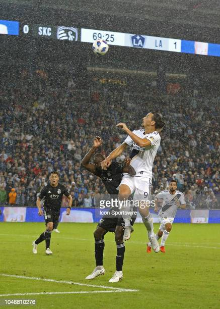 Los Angeles Galaxy forward Zlatan Ibrahimovic and Sporting Kansas City defender Ike Opara fight for a header in driving rain in the second half of an...