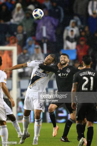Los Angeles Galaxy forward Zlatan Ibrahimovic and Sporting Kansas City midfielder Ilie Sanchez grab at each other's necks position for a header in...