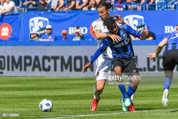 Los Angeles Galaxy forward Zlatan Ibrahimovic holds Montreal Impact midfielder Raheem Edwards while looking at the ball during the LA Galaxy versus...