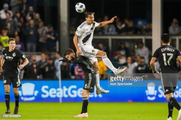 Los Angeles Galaxy forward Zlatan Ibrahimovic leaps for a header over Sporting Kansas City midfielder Ilie Sanchez during the MLS regular season...