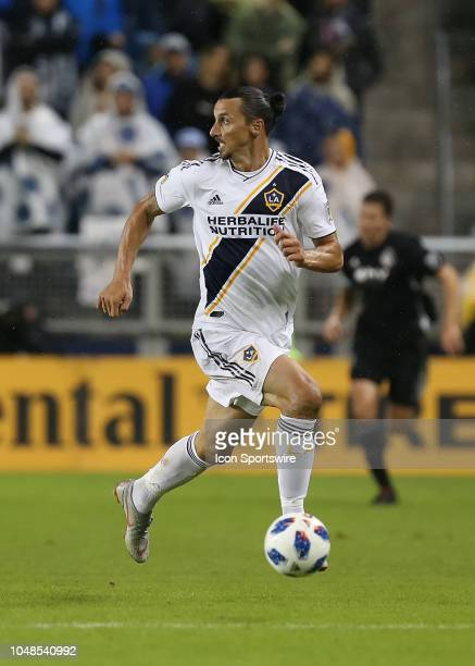 Los Angeles Galaxy forward Zlatan Ibrahimovic looks back for the defense in the first half of an MLS match between the LA Galaxy and Sporting Kansas...
