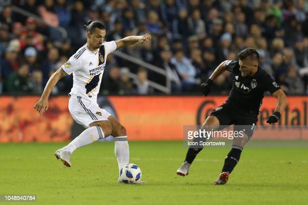 Los Angeles Galaxy forward Zlatan Ibrahimovic looks to make a move on Sporting Kansas City forward Diego Rubio in the first half of an MLS match...