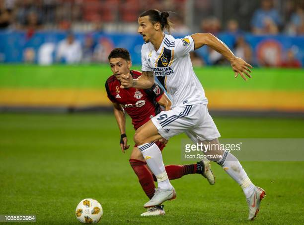 Los Angeles Galaxy forward Zlatan Ibrahimovic moves the ball against Toronto FC midfielder Marco Delgado on September 15 at BMO Field in Toronto ON...