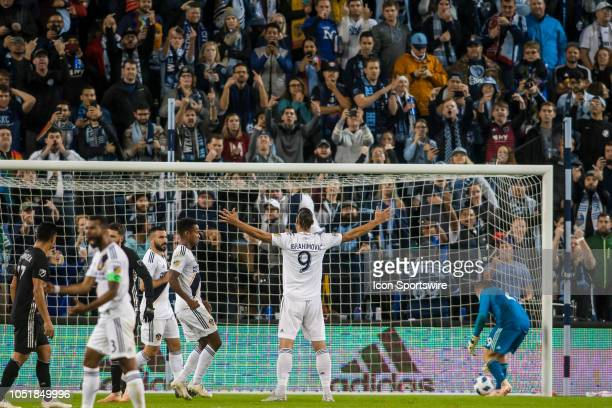 Los Angeles Galaxy forward Zlatan Ibrahimovic poses in front of the Sporting Kansas City supporters section after scoring a penalty kick goal during...