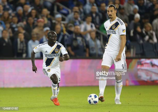 Los Angeles Galaxy forward Zlatan Ibrahimovic prepares to pass as Los Angeles Galaxy midfielder Ema Boateng makes a run in the first half of an MLS...