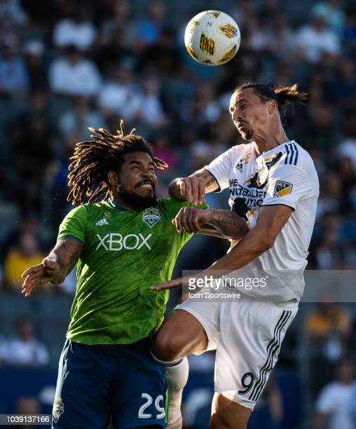 Los Angeles Galaxy forward Zlatan Ibrahimovic right and Seattle Sounders defender Roman Torres battle for a header during the MLS regular season...