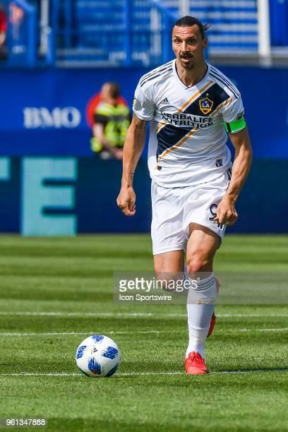 Los Angeles Galaxy forward Zlatan Ibrahimovic runs with the ball during the LA Galaxy versus the Montreal Impact game on May 21 at Stade Saputo in...