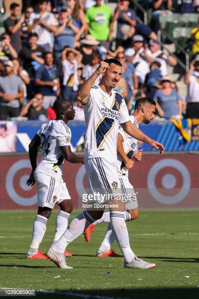 Los Angeles Galaxy forward Zlatan Ibrahimovic salutes the crowd after scoring the opening goal in the 1st half during a MLS game between the Seattle...