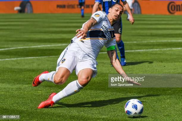 Los Angeles Galaxy forward Zlatan Ibrahimovic slides trying to kick the ball during the LA Galaxy versus the Montreal Impact game on May 21 at Stade...