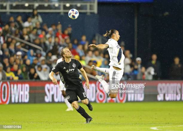 Los Angeles Galaxy forward Zlatan Ibrahimovic takes a dive during a header against Sporting Kansas City defender Seth Sinovic in the first half of an...