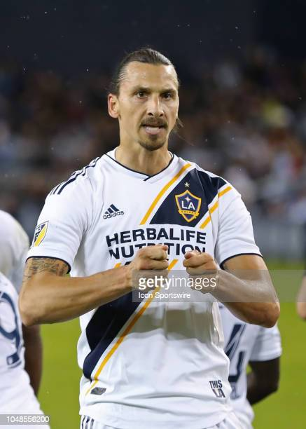Los Angeles Galaxy forward Zlatan Ibrahimovic taunts Sporting KC fans by beating on a drum after scoring on a penalty kick in the first half of an...