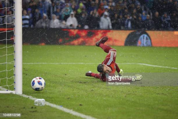 Los Angeles Galaxy goalkeeper David Bingham watches as a shot from Sporting Kansas City midfielder Graham Zusi goes of the post in the second half of...