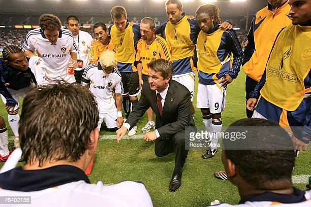 Los Angeles Galaxy head coach Frank Yallop speaks to his team prior to overtime against Pachuca during their Superliga Final match at Home Depot...